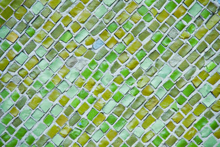Background of green ceramic mosaic. A wall with a textured surface