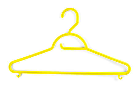 Yellow plastic hanger for clothes on a white background Stock Photo
