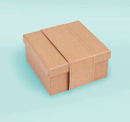 Cardboard box for packaging on a green background Banque d'images