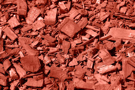 Red wood chips mulch for garden landscaping as pattern background