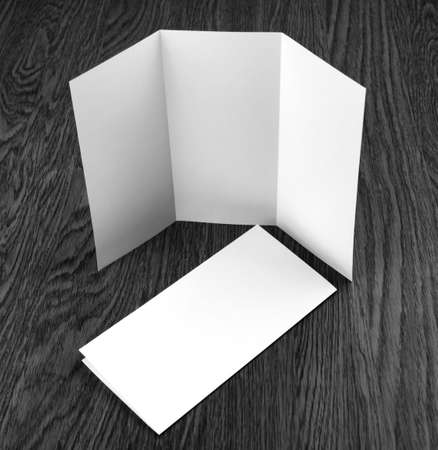 Mockup of white booklet on wooden background