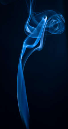 Abstract blue smoke swirls on dark background