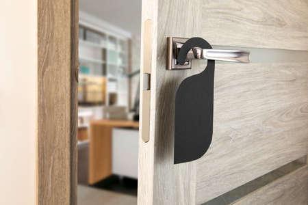 A door handle with blank paper hanger