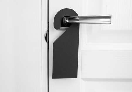 A door handle with blank paper hanger Stock Photo