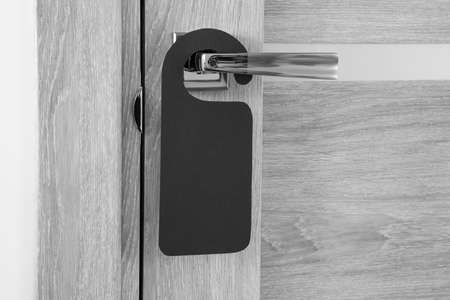 A door handle with blank paper hanger