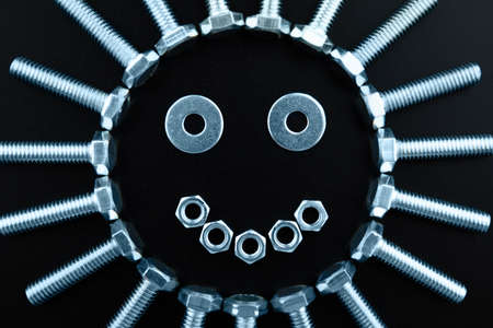 The sun icon created from nuts, bolts and assorted hardware