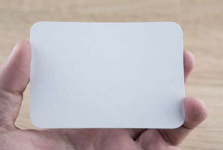 A man holding a white business card Stock Photo