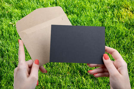 A woman holding a black business card Stock Photo