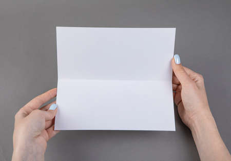 A woman holding white booklet. Identity template