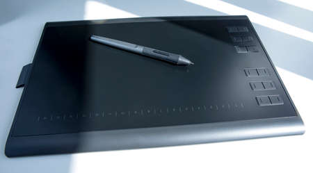 Close up of graphic tablet with pen