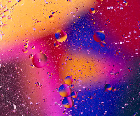 Оxygen bubbles in a liquid. Beautiful structure of water in macro a natural background Standard-Bild