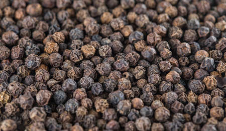 Close up of Black peppers peas background