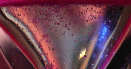 Bubbles Rising In A Glass With Pink Liquid