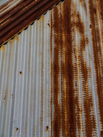 Old galvanized iron roof of a house in Thailand photo