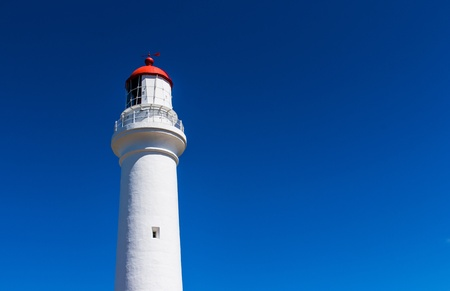 Split Point Lighthouse with blue sky on the Great Ocean Road, Victoria, Australia photo