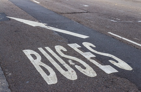 White bus lane sign on the tarmac street photo