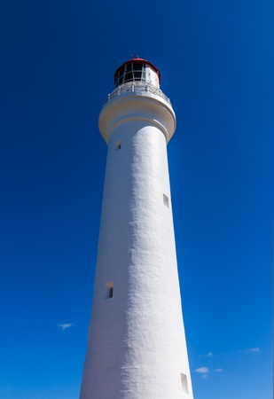 split road: Split Point Lighthouse with blue sky on the Great Ocean Road, Victoria, Australia