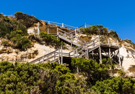 The wooden stairway from cliff to  beach on the great ocean road in Victoria, Australia photo