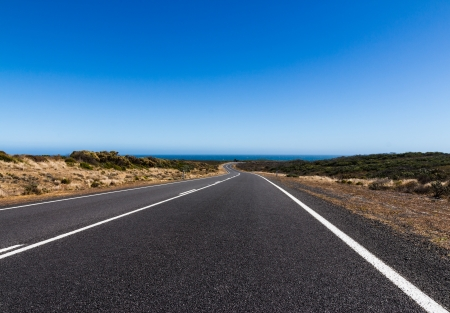 The straight and bend road on the great ocean road in Victoria Australia photo
