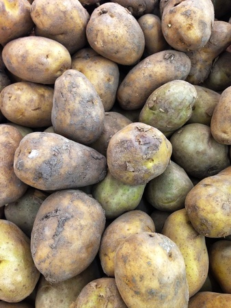 traditional textured: Many fresh potatoes in the market Stock Photo