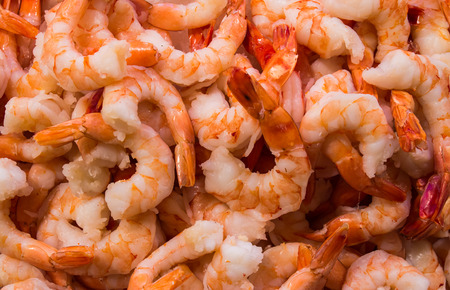 shrimp: Many peeled shrimps on ice in the public market