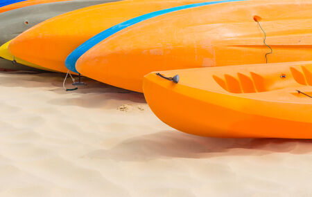 Many colorful kayaks orderly dock on the beautiful beach photo