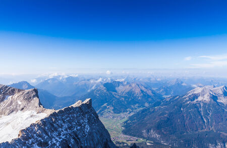 The mountain view with blue sky at Top of Germany, Zugspitze in Germany photo