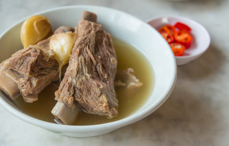 popular soup: Bak Kut Teh in the white bowl on the table