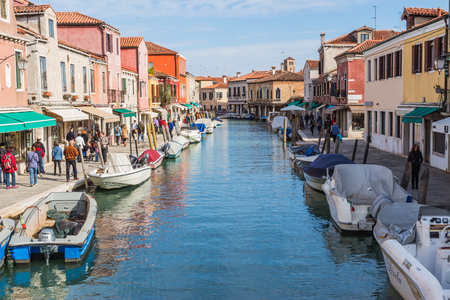 Murano: VENICE, ITALY - OCTOBER 17, 2015: The view of Murano lives from the bridge across the canal in Murano Island, Venice, Italy