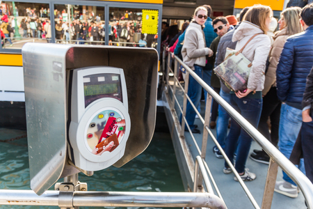 validating: VENICE, ITALY - OCTOBER 17, 2015: The machine for validating ticket at the water bus stop in front of Venezia Santa Lucia railway station in Venice, Italy