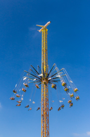 chairoplane: Munich, Germany - October 3, 2014: The chairoplane working at the Oktoberfest, the worlds largest beer festival, in Munich, Germany Editorial
