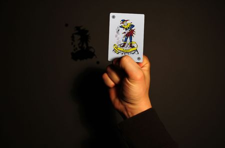 cast off: holding up a joker card in your hand