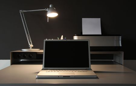 frontal Home office desk whit lamp, laptop and printer photo