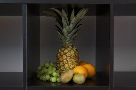 composizione di frutta insieme in un quadrato Archivio Fotografico - 5137768
