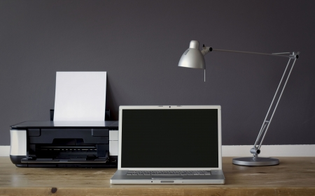 paper screens: frontal Home office desk with laptop and printer