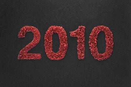 specular: 2010 new year written in sand texture