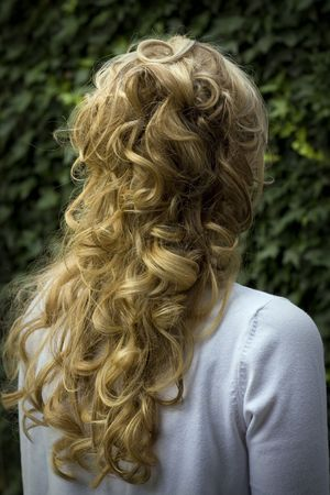 blonde curly hair: bach of the head of a woman