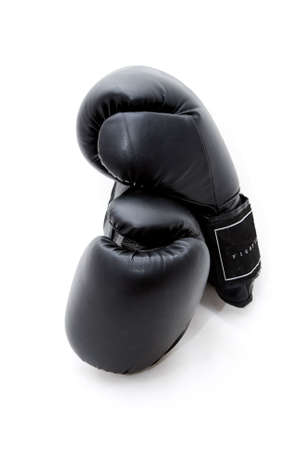 Two black boxing gloves on a white background.