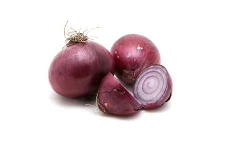 Several red onions on a white background. Stock Photo
