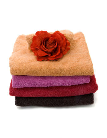 Different colored towels on a white background. Stock Photo