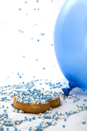 Rusk sprinkled with blue mice on a white background.