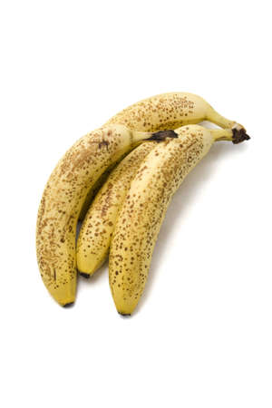 overripe: A bunc of overripe bananas on a white background.