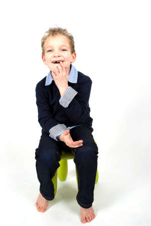 Young boy is pointing at his mouth. Stock Photo