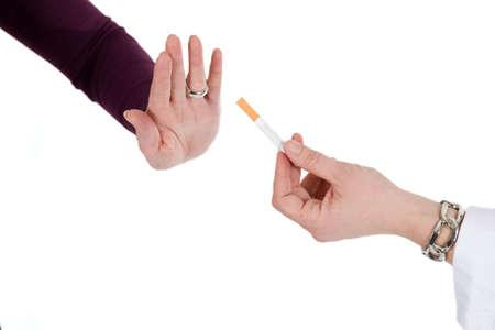 refusing: A person is refusing a cigarette.