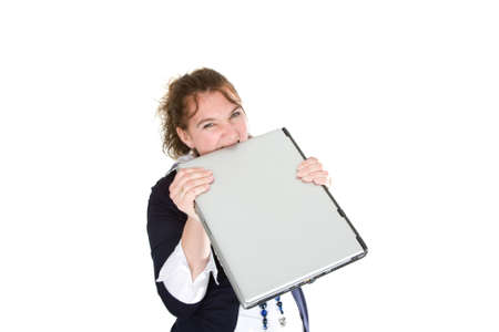 A frustrated woman is chewing on her laptop Stock Photo - 6471095