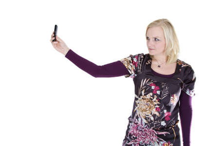 A blonde woman is taking a picture with her phone. photo