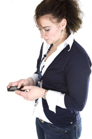 A woman is creating a text message.