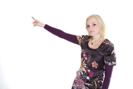 A woman is pointing to something above. photo