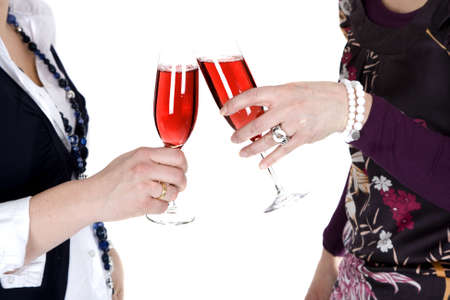 Two woman are toasting with champagne photo