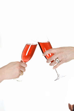 A good toast with two champagne glasses and champagne.